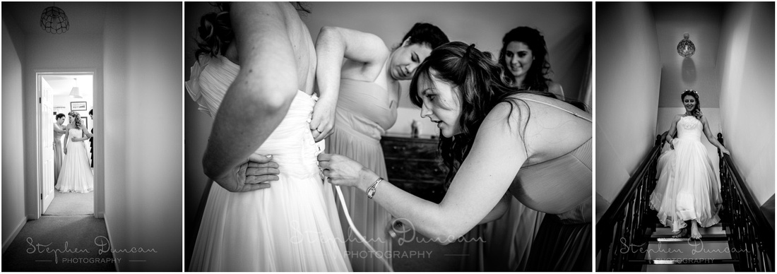The bride gets into her wedding dress
