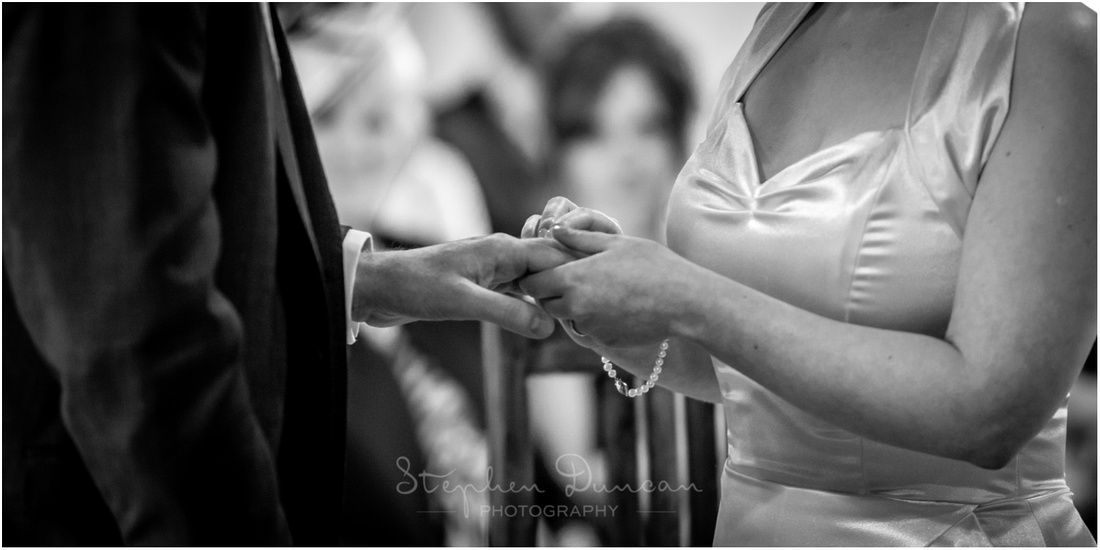 Black and white photo of exchange of rings