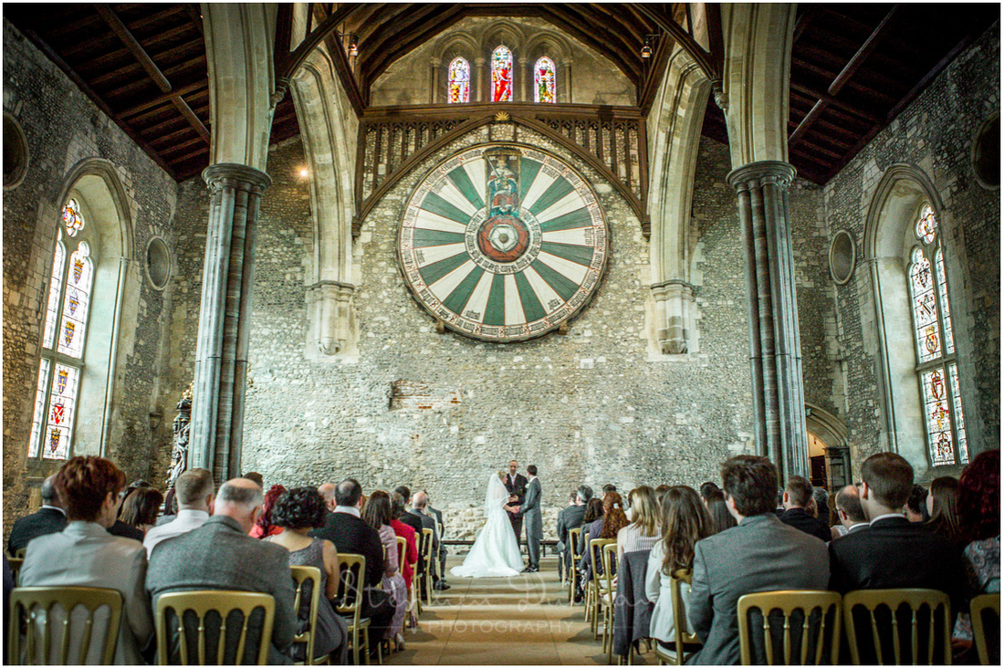 View from the back of the hall with the couple making their vows beneath King Arthur's Round Table