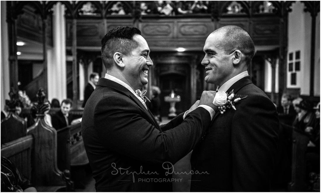 The best man makes sure that the groom is looking his best, ready for the bride to make her entrance