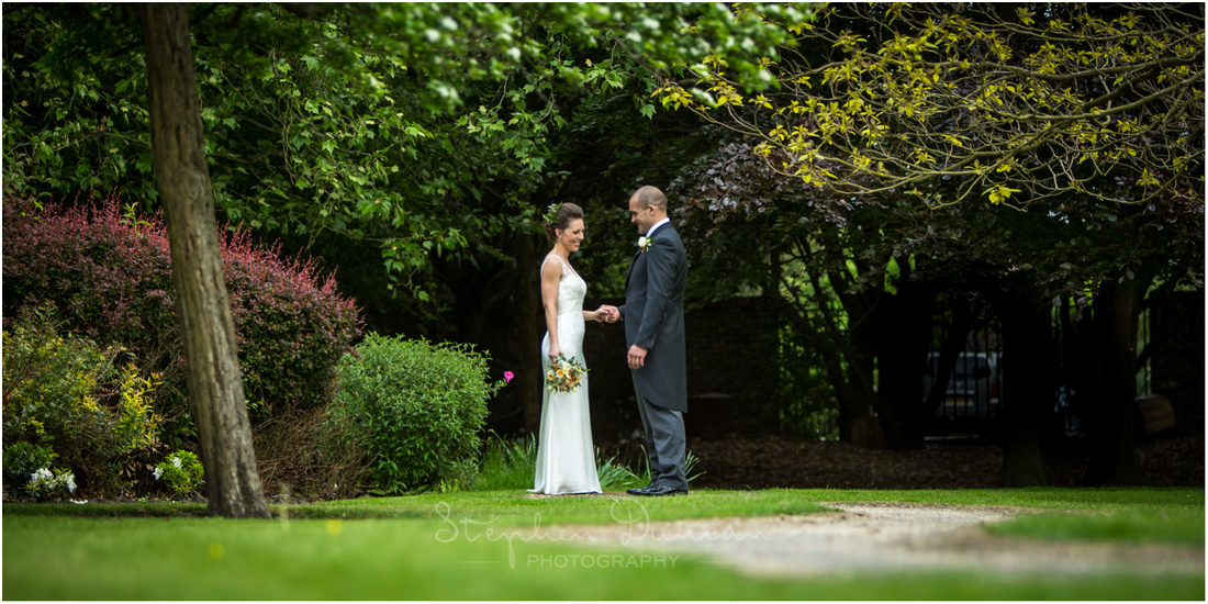 Bride and groom together alone in gardens