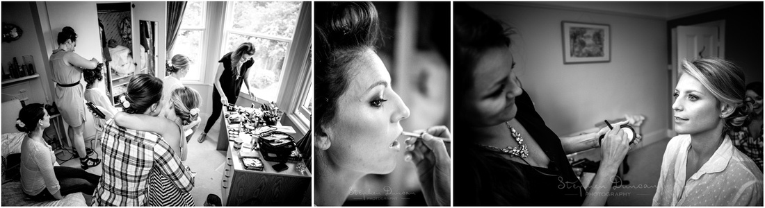 Black and white photo of bride and bridesmaids during make-up