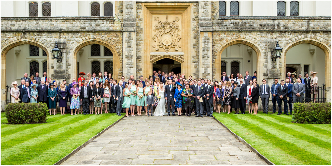 A wedding photograph of all the guests stood on the steps and in the cloisters of Christ's Church in Dulwich