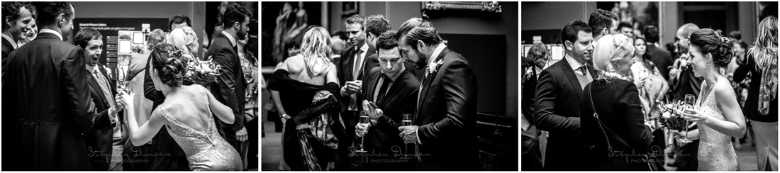 Black and white photography of bride and guests during wedding reception