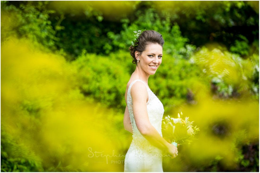 Bride alone in grounds of reception venue
