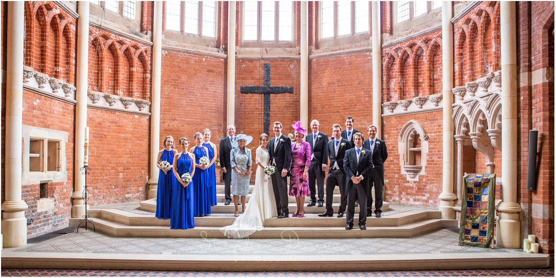 Family and wedding party at the front of the church