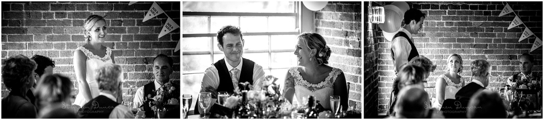 Black and white photo of both bride and groom making speeches at the end of the wedding breakfast