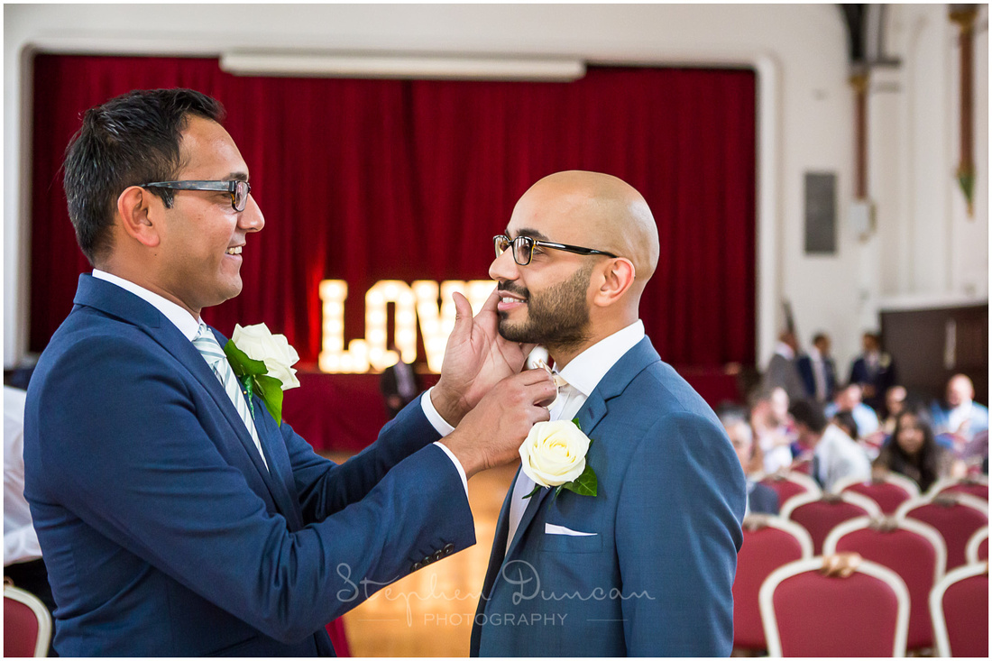 The best man makes sure that the groom looks the part, ready to receive his bride