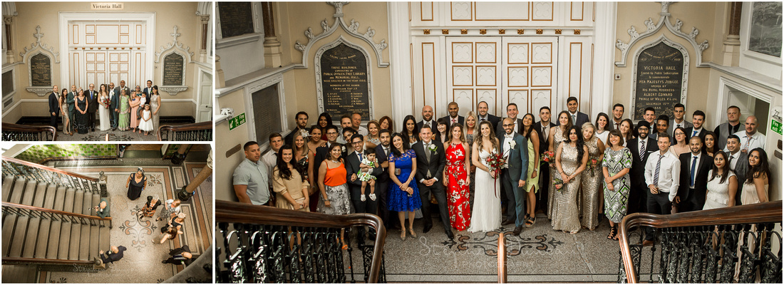 Wedding party photos on staircase outside ceremony room