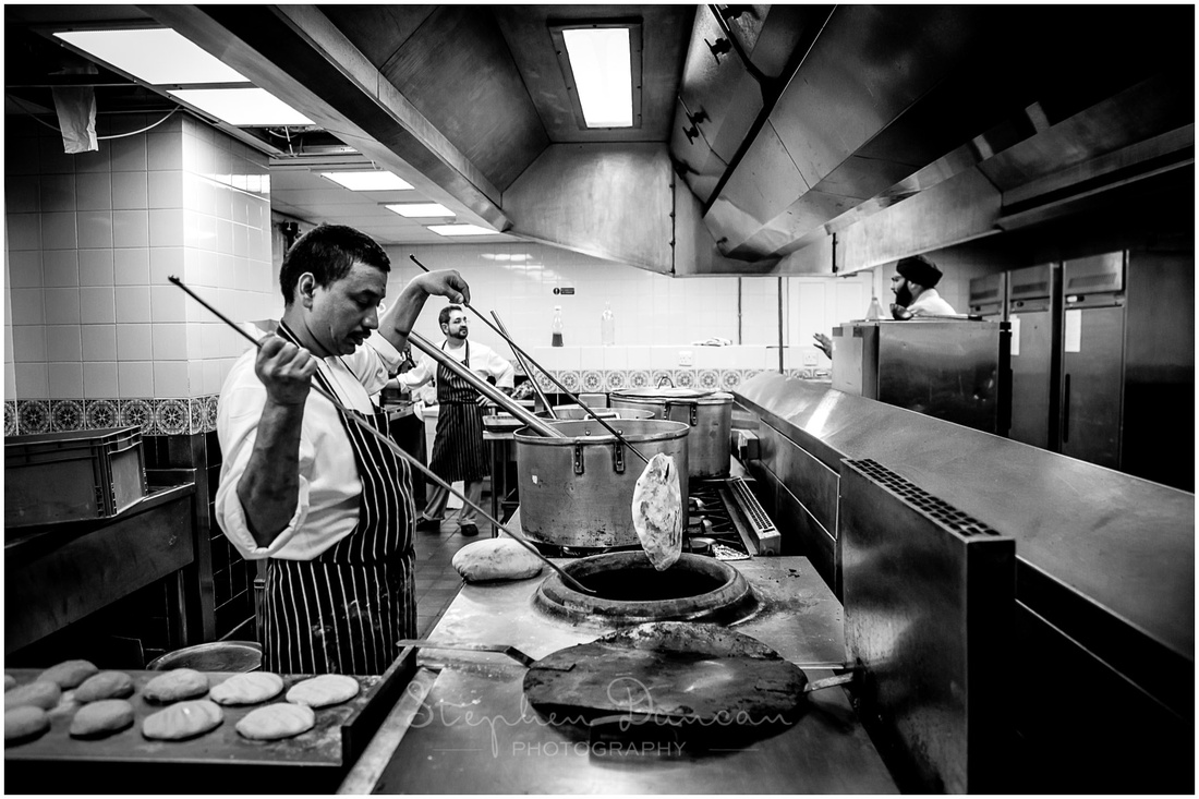 The chefs prepare naan bread in the town hall's kitchens