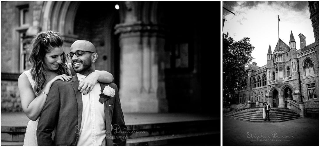 The bride and groom in black and white on the steps of London's Ealing Town Hall wedding venue