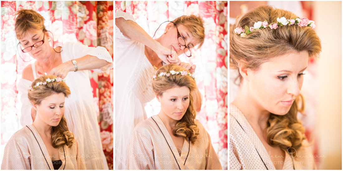 Beautiful floral details are applied to the bride's hair