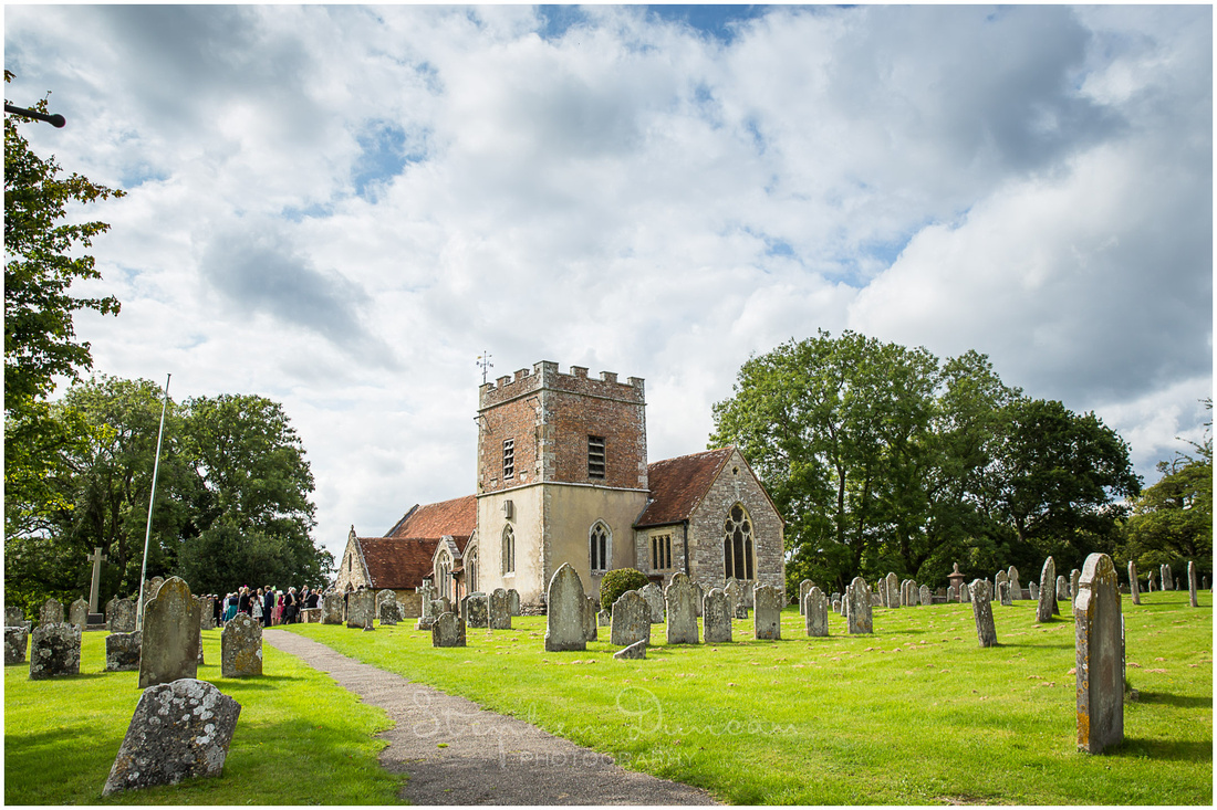 View of exterior or St John the Baptist Church, Boldre, from the South side as wedding guests congregate