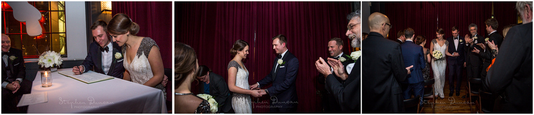 Colour images of bride and groom signing the register