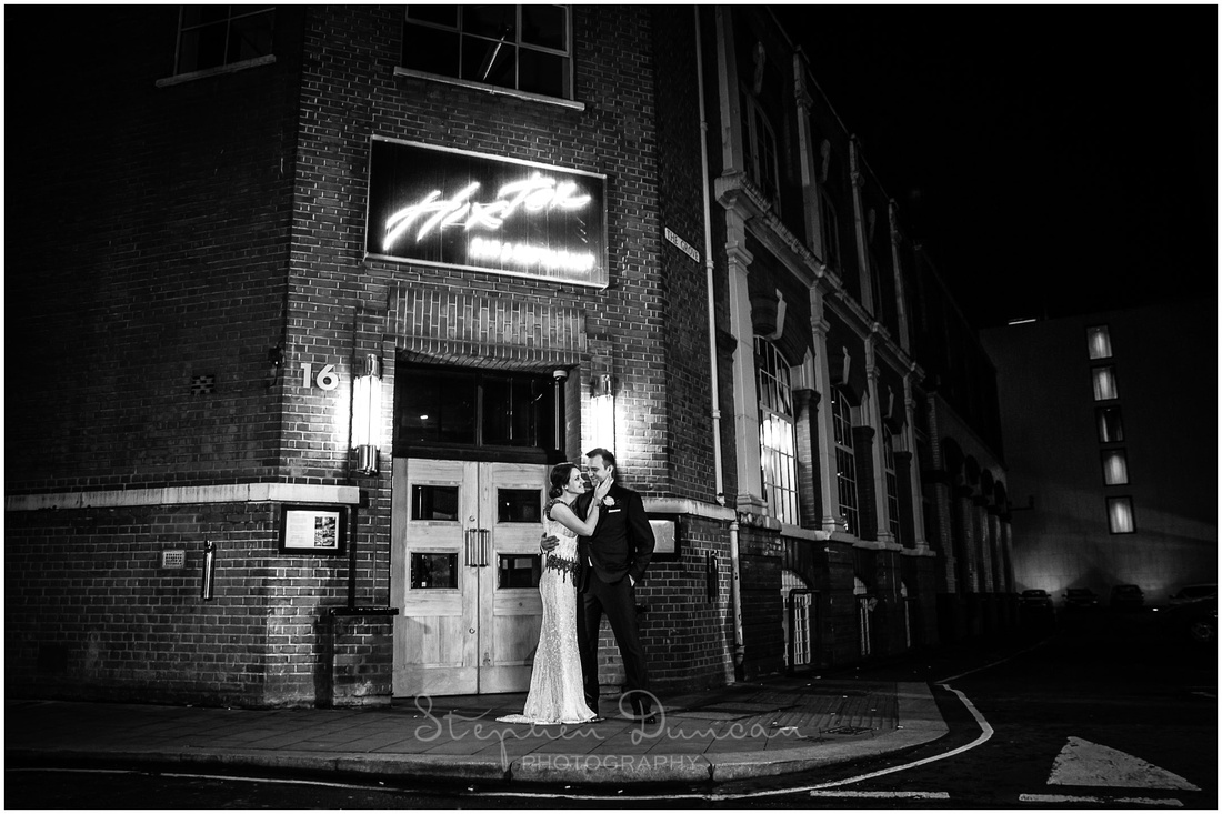 Exterior of Hixter restaurant with bride and groom, black and white photo