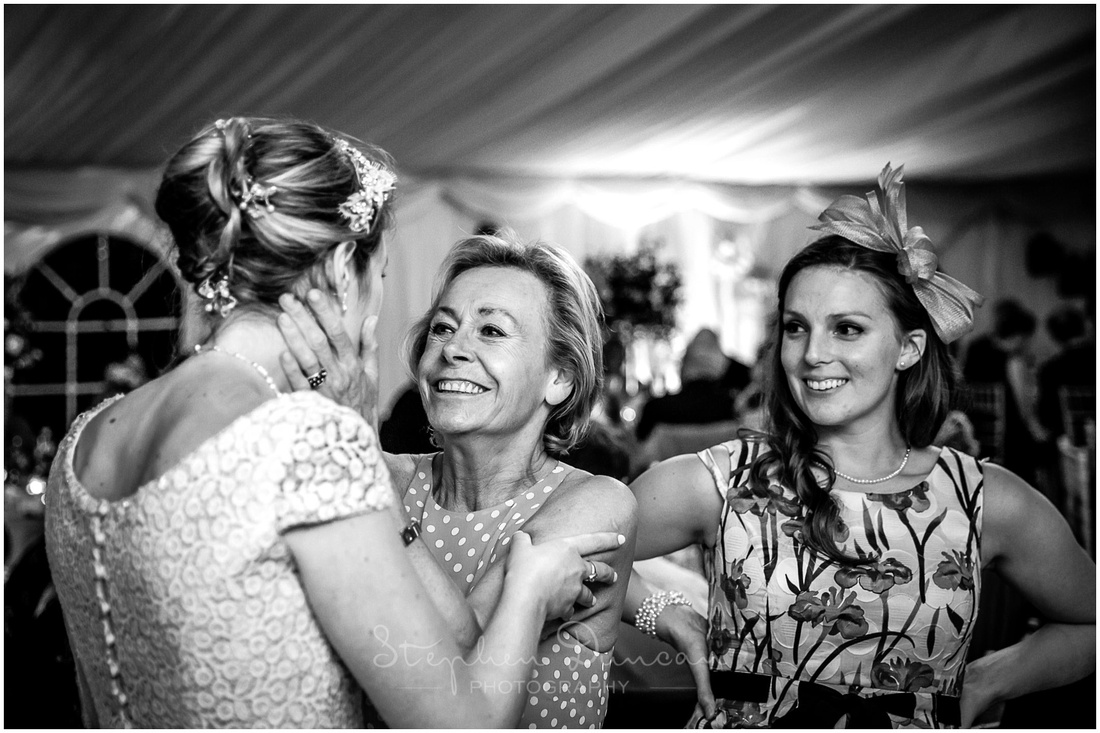 The bride's aunt congratulates her on her marriage
