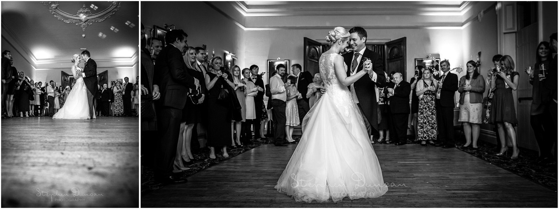 Black and white photograph of bride and groom first dance