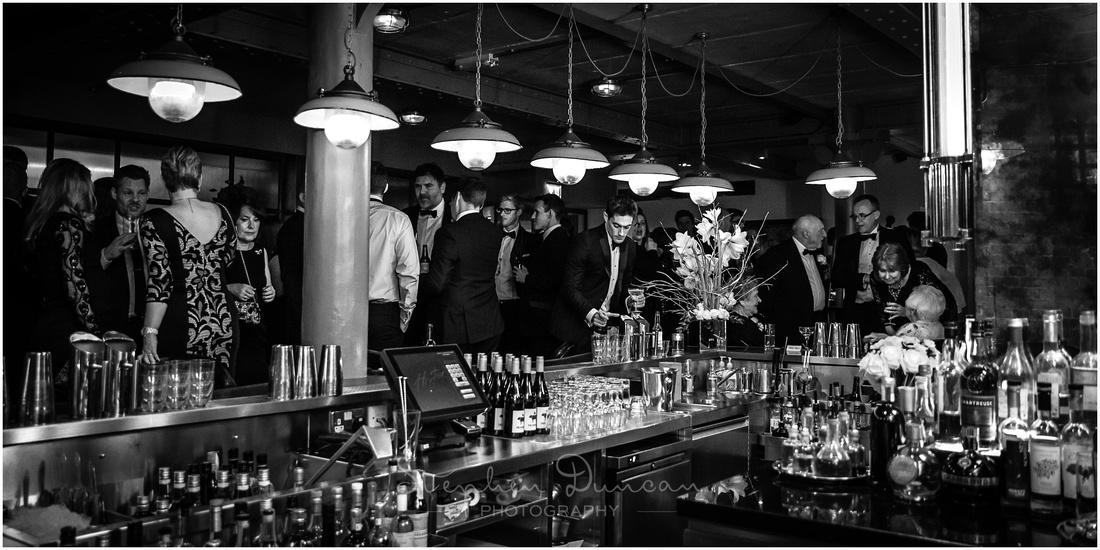 Panaromic black and white image of downstairs cocktail bar at Hixter Bankside restaurant