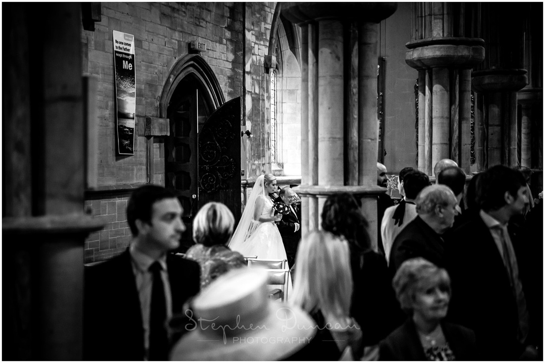 The bride enters at the back of the church