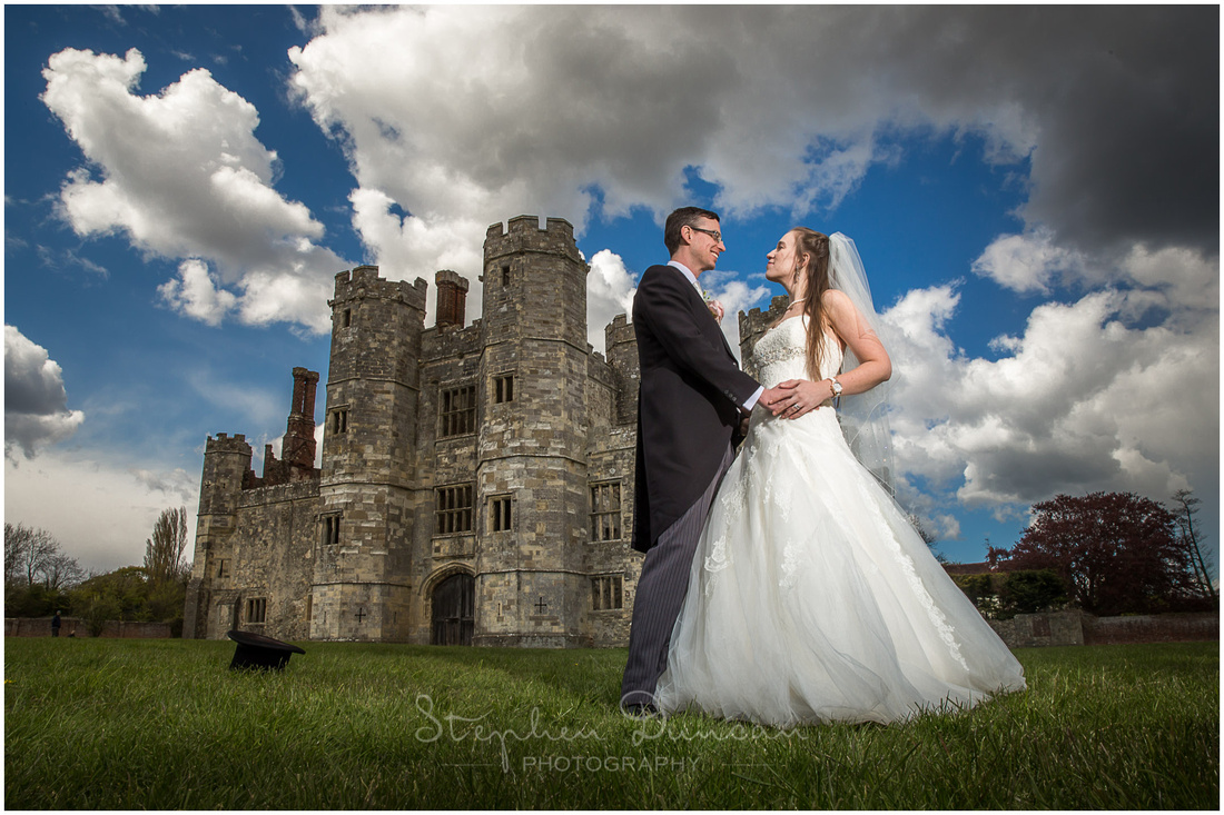 Colour photo of couple at Titchfield Abbey for Spring wedding with blue skies