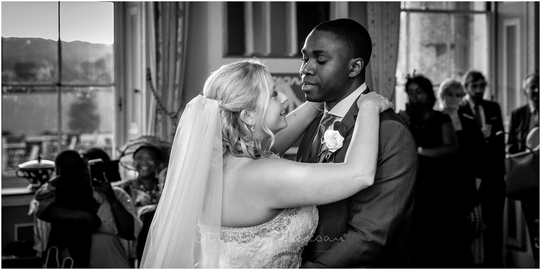 Black and white photograph of bride and groom's first dance
