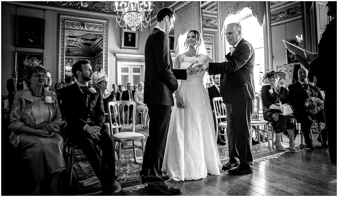 The bride's father passes her hand to the groom at the start of the wedding