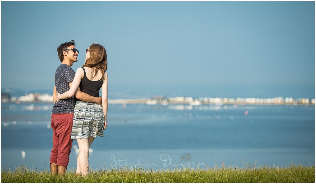 Couple portrait with view across Christchurch Harbour