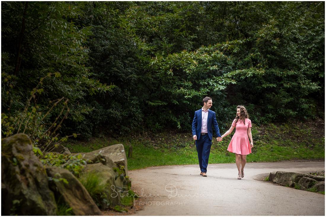 Couple walking towards camera along a winding pathway