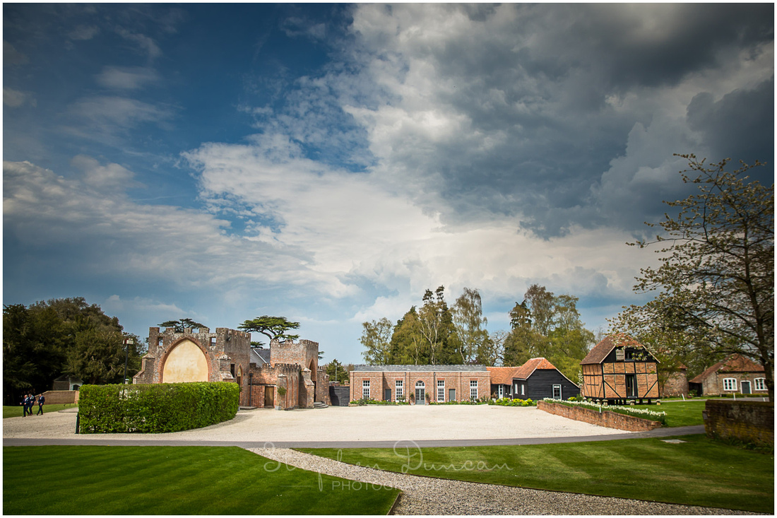 Wedding venue barn and accommodation set around a central courtyard in Spring sunshine
