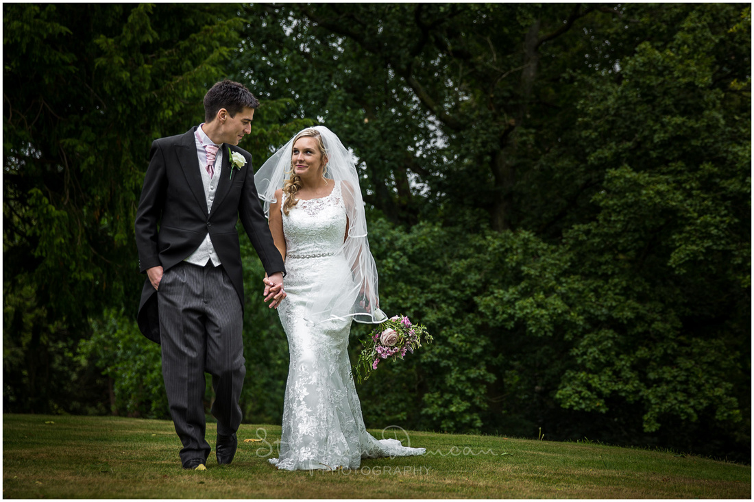 Couple walking in the grounds of Langrish House Hotel