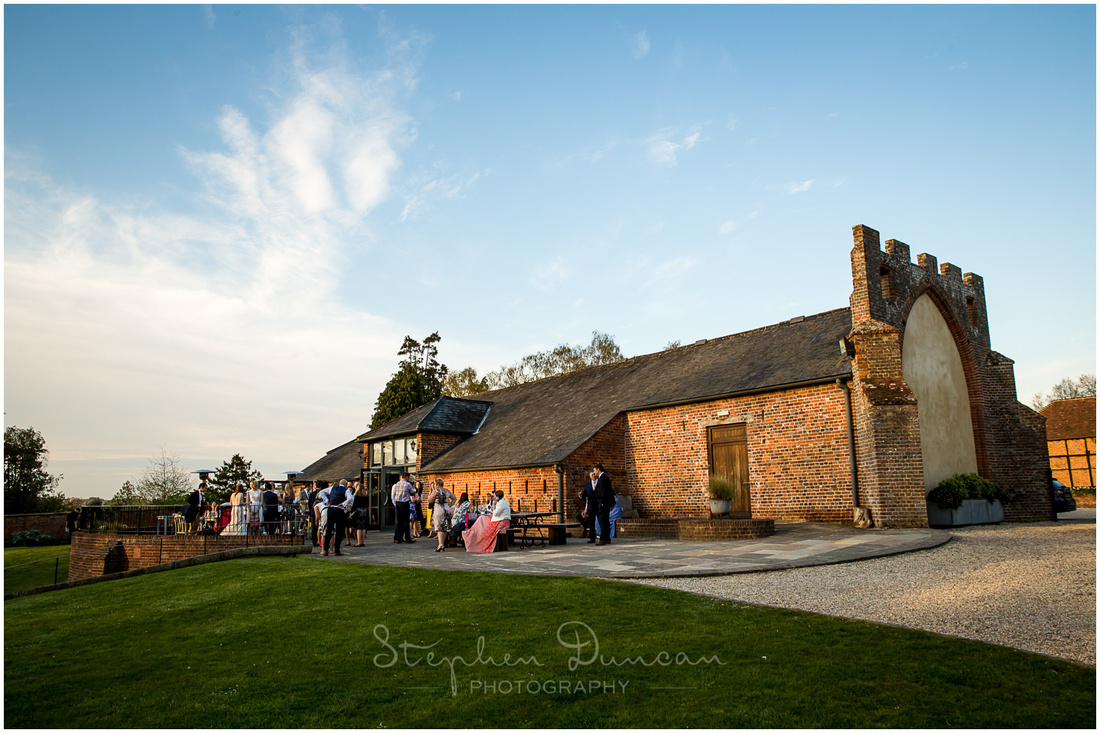 The last of the day's sunlight catches the barn used as the wedding venue
