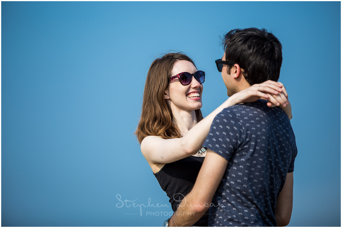 Colour portrait of couple with blue sky and sunshine