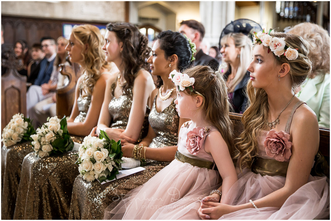 Colour photo of bridesmaids and flower girls during wedding