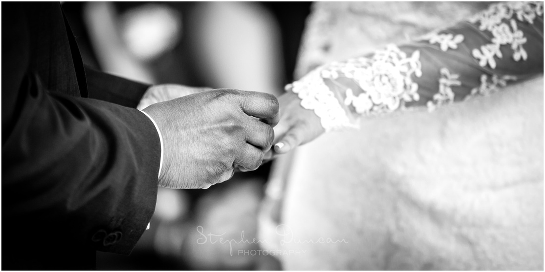 The groom places the ring on the bride's finger