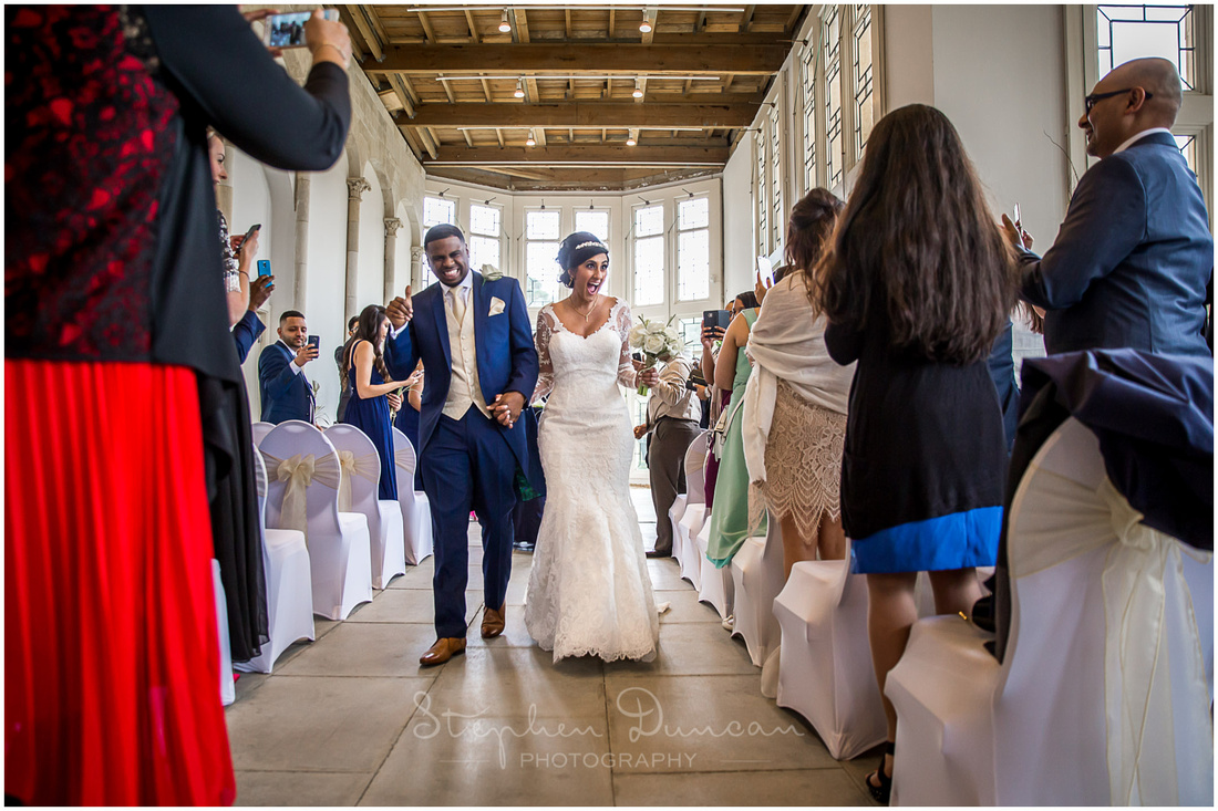Bride and groom walk down the aisle as husband and wife