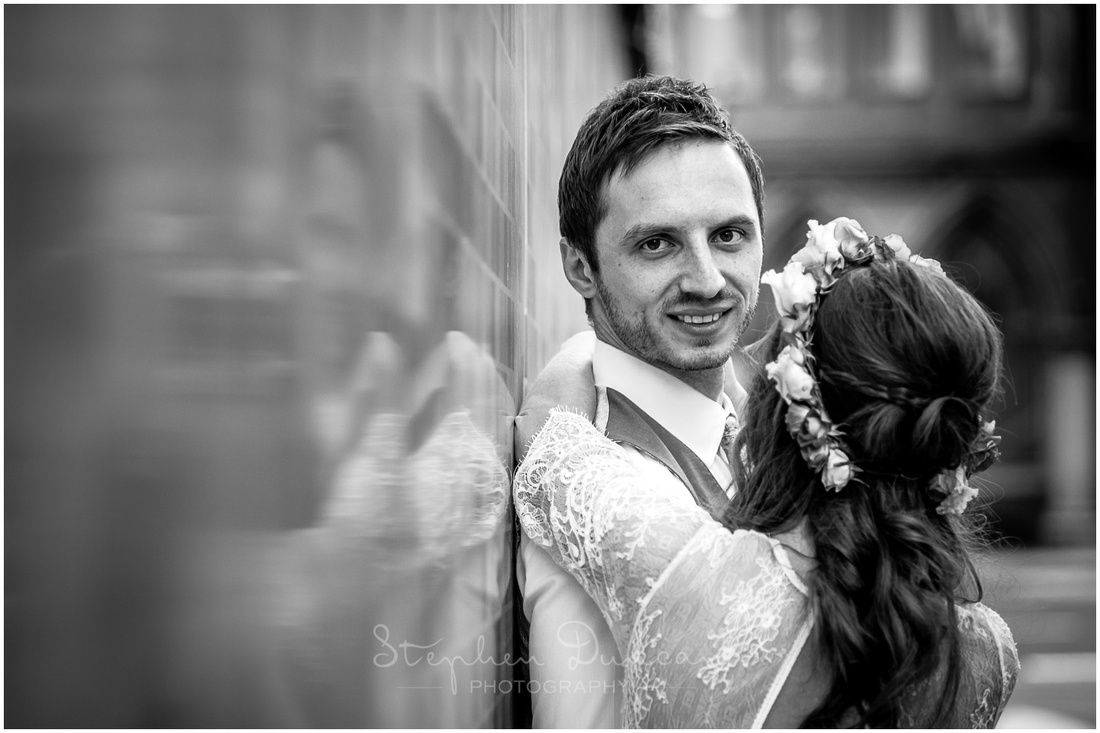 Black and white portrait of groom with bride