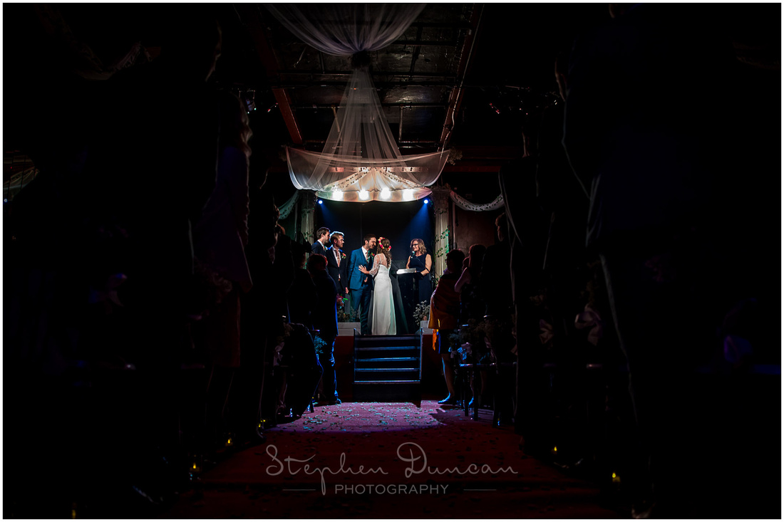 The bride and groom meet on stage at the start of the marriage ceremony