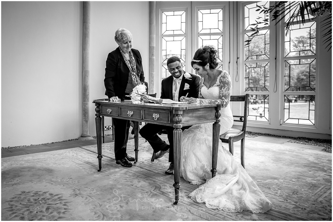 The register of marriage is signed by the bride and groom