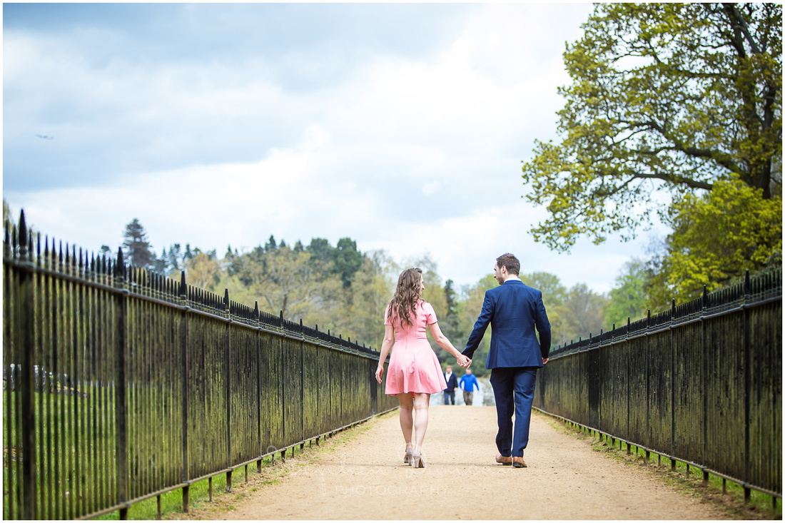 Leading lines from metal railings draw focus to the couple