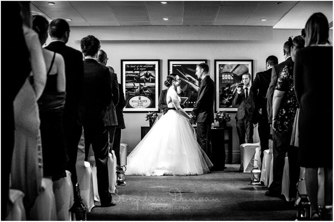 Bride and groom face each other to make their vows