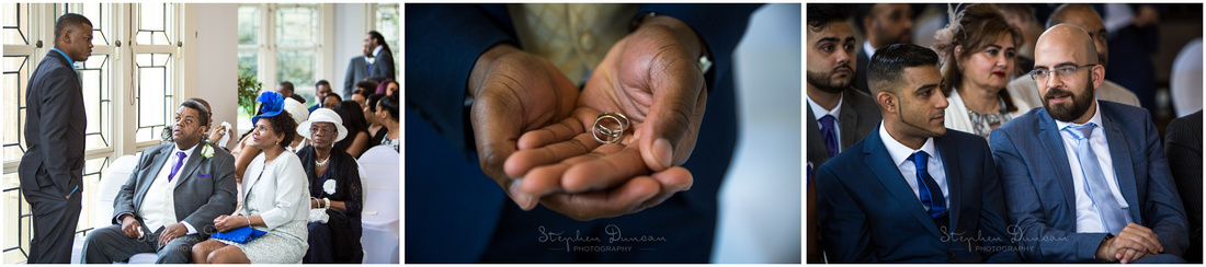 The best man displays the wedding rings as guests talk amongst themselves