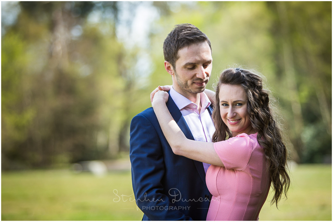 Colour photograph of bride and groom in sunshine