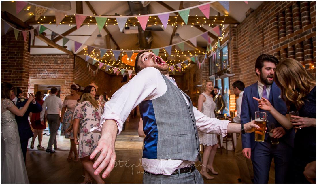 A wedding guest dances enthusiastically!
