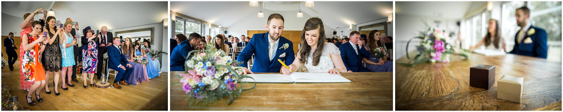 The newly-married couple's paparazzi moment as wedding guests photograph them signing the register