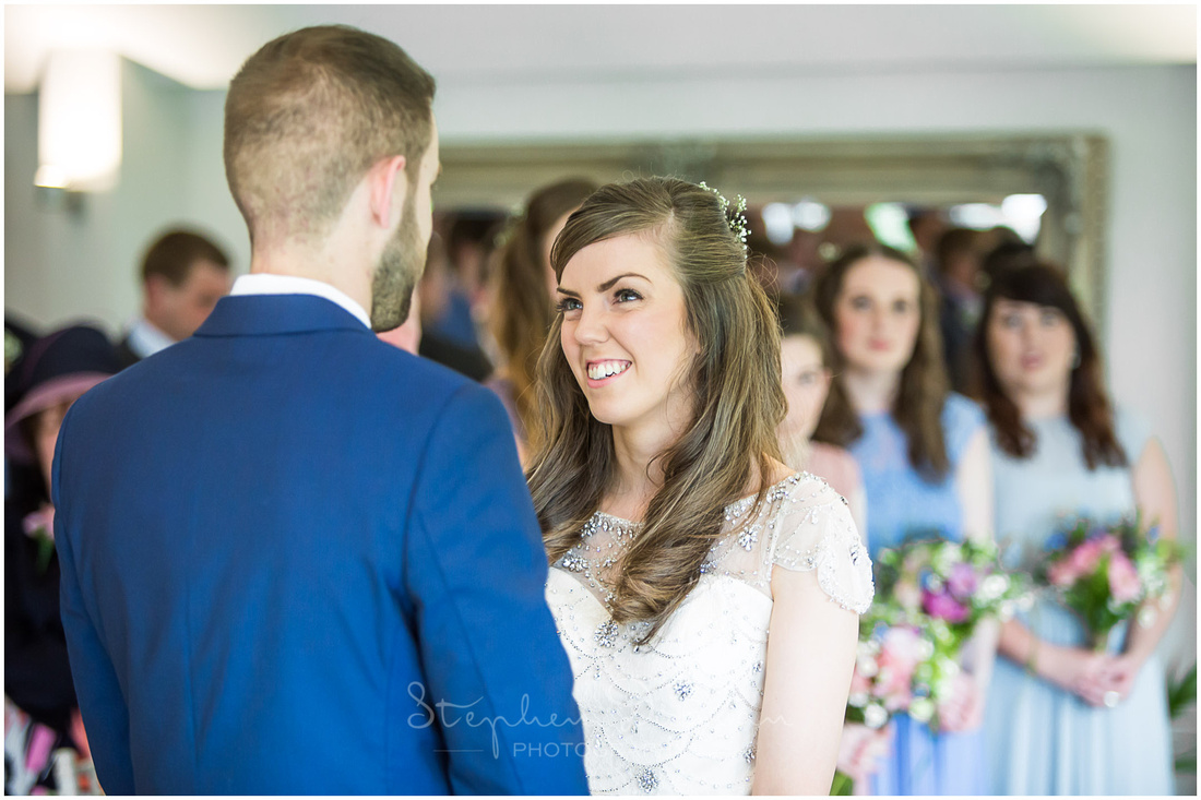 The bride looks up to her new husband during the wedding ceremony