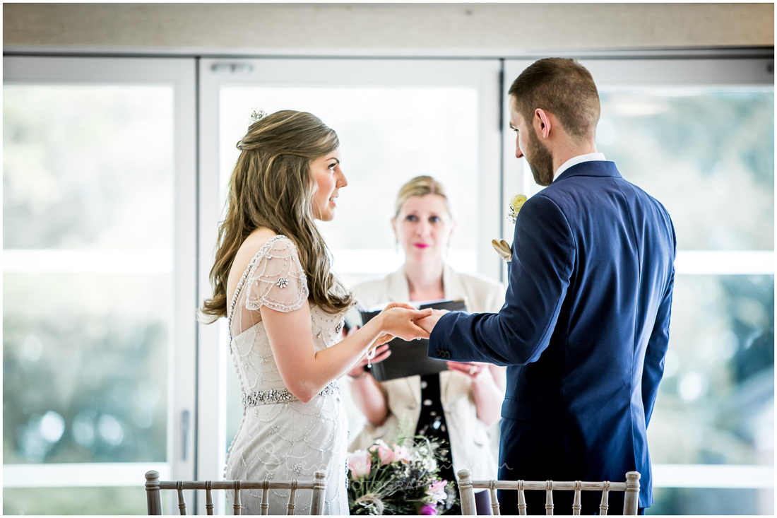 Bride and groom symbolically exchange rings to seal their marriage