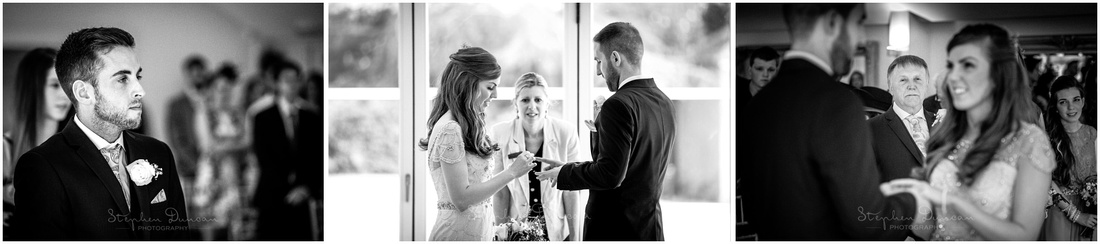 The bride places the wedding ring on the groom's finger