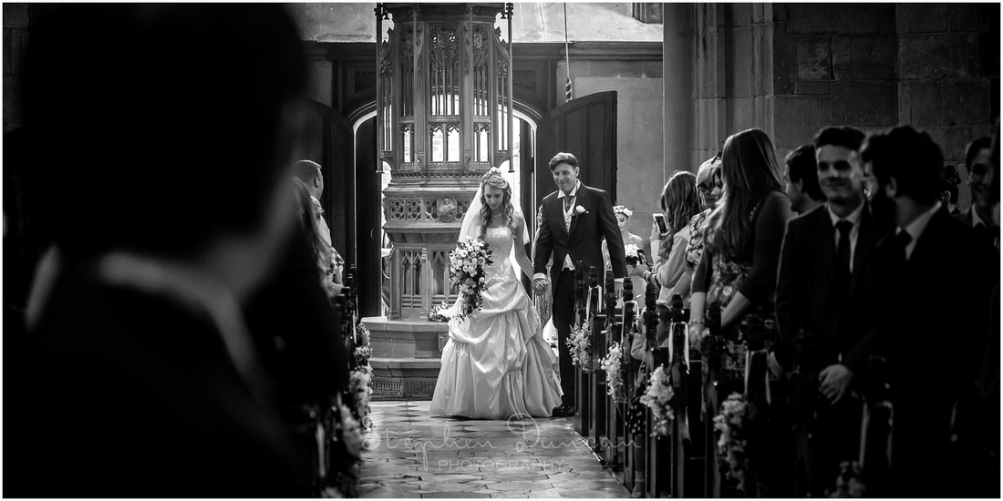 The bride enters the church on her father's arm