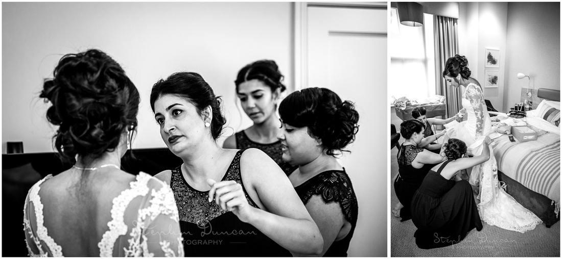 Bridesmaids do a final check of the bride's make-up and help her into her dress