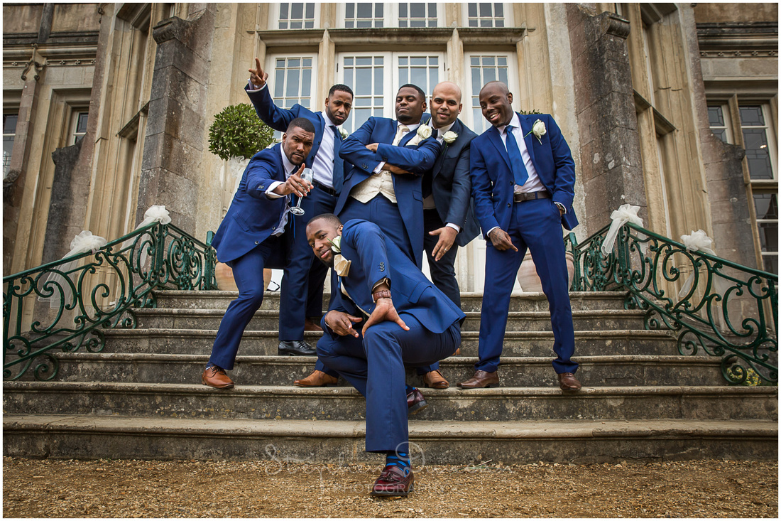 The groom poses with his best man and ushers